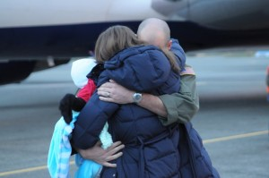 Hug from homecoming military spouse and baby