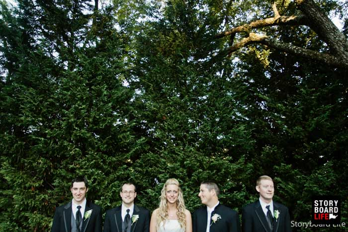 wedding portraits bride with groomsmen